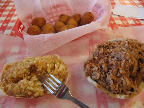 The tray with barbecue slaw and hush puppies